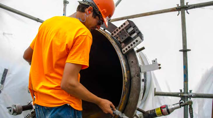 A field machinist makes preparations to ensure a reliable weld on the pipes for a natural gas processing and compressor station. Tri Tool's attention to quality and safety enabled Sauer Group to perform excellent welds at a rapid pace, meeting the project's schedule constraints.