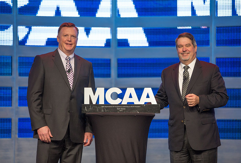 MCAA President Greg L. Fuller presents Immediate Past President Tom Stone with a token of appreciation for his service.