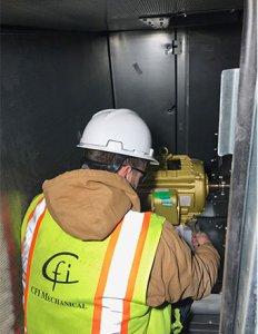 CFI Worker Installs Carrier Equipment